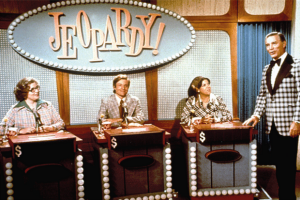 Art Fleming and contestants on the nighttime syndicated Jeopardy, 1974