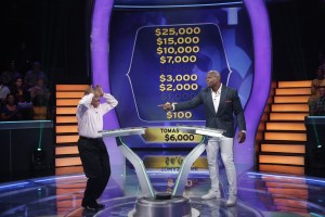"Host Terry Crews on the set of ""Millionaire."""