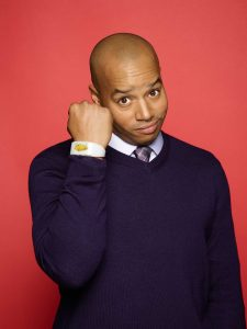 Host Donald Faison models the Win Watch, an interactive LED bracelet that chooses contestants on the show.